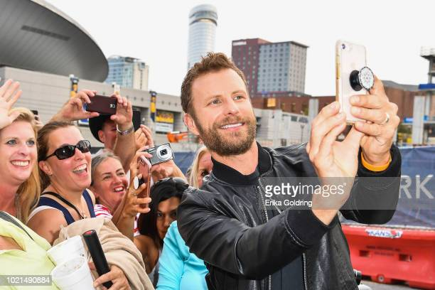 Dierks Bentley takes photos with fans during the 12th Annual ACM Honors at Ryman Auditorium on August 22 2018 in Nashville Tennessee