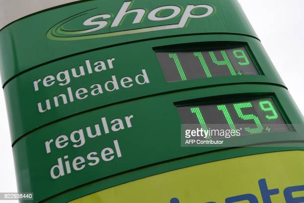 Diesel and petrol prices are displayed at a filling station in Manchester on July 26 2017 Britain said July 26 2017 it will outlaw the sale of new...