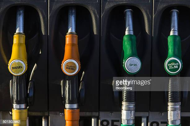 Diesel and regular fuel pumps sit at a gas station operated by Total SA in LucLaPrimaube near Rodez France on Friday Dec 11 2015 Oil extended...