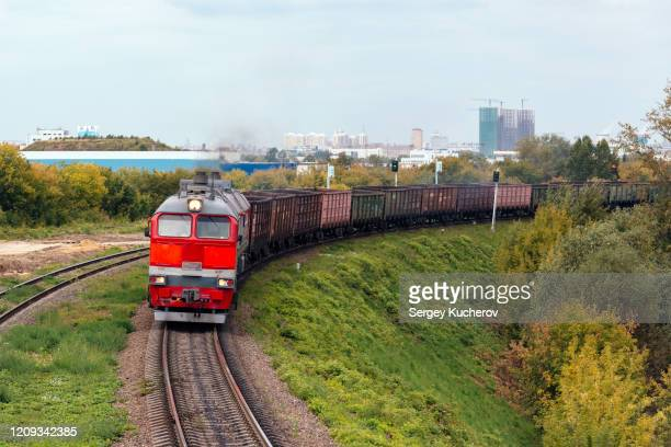 diesel locomotive with an empty freight train - 貨物列車 ストックフォトと画像