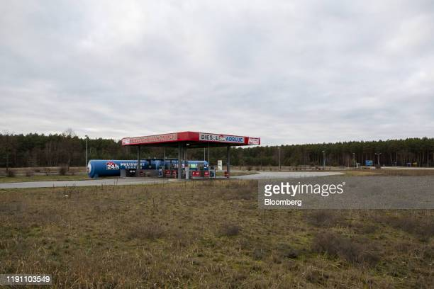 A diesel truck refueling station stands near a forested area and the proposed location for a Tesla Inc Gigafactory in Gruenheide Germany on Saturday...