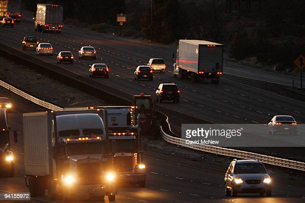 Diesel trucks and cars travel the 10 freeway on December 8 2009 near Banning California Sustained global warming shows no sign of letting up...