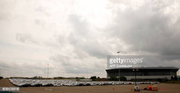 Diesel Volkswagen and Audi vehicles that VW bought back from consumers sit in the parking lot of the Pontiac Silverdome on August 4 2017 in Pontiac...