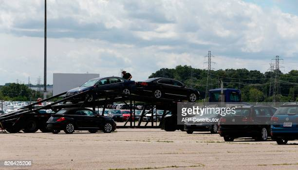 A Diesel Volkswagen that the company bought back from consumers is loaded on a trailer in the parking lot of the Pontiac Silverdome on August 4 2017...
