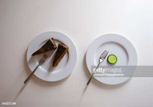 diet contrast - imbalance stock photos and pictures