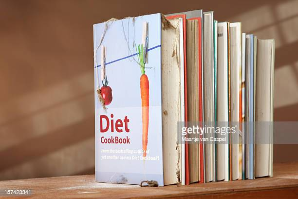 Diet cookbook on shelf with other books