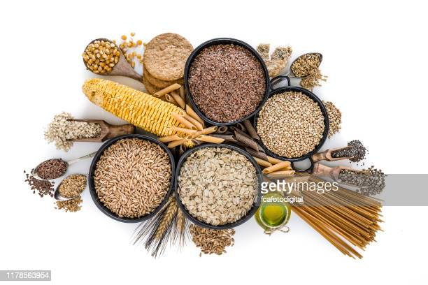dietary fiber: large group of wholegrain food shot from above on white background - cereal plant stock pictures, royalty-free photos & images
