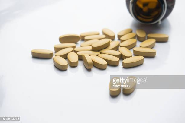 dietary supplement tablet and Vitamin tablet Medicine (pharmacy) and bottle  on white background