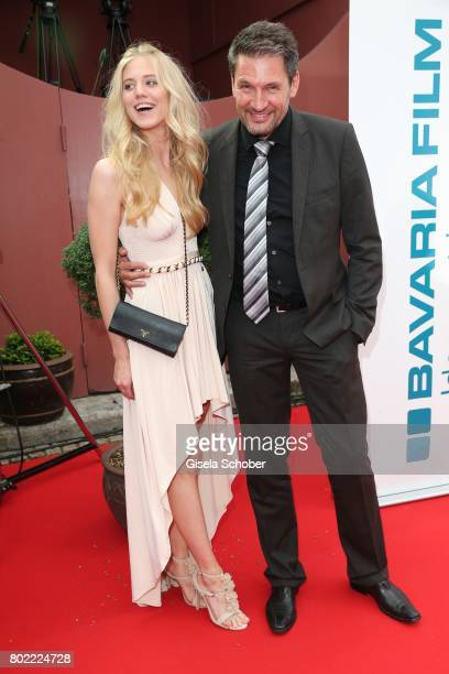 Dieter Bach and Larissa Marolt during the Bavaria Film reception during the Munich Film Festival 2017 at Kuenstlerhaus am Lenbachplatz on June 27...