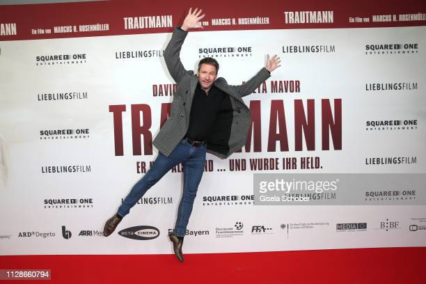 Dieter Bach jumps during the premiere of the film Trautmann at Mathaeser Filmpalast on March 4 2019 in Munich Germany