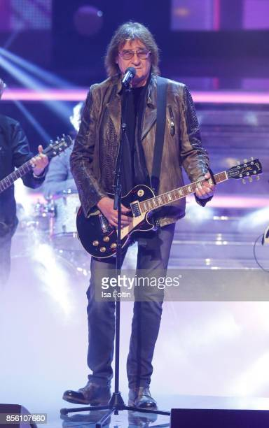 Dieter Birr member of the band Puhdys performs with Rock Legenden during the tv show 'Willkommen bei Carmen Nebel' at TUI Arena on September 30 2017...