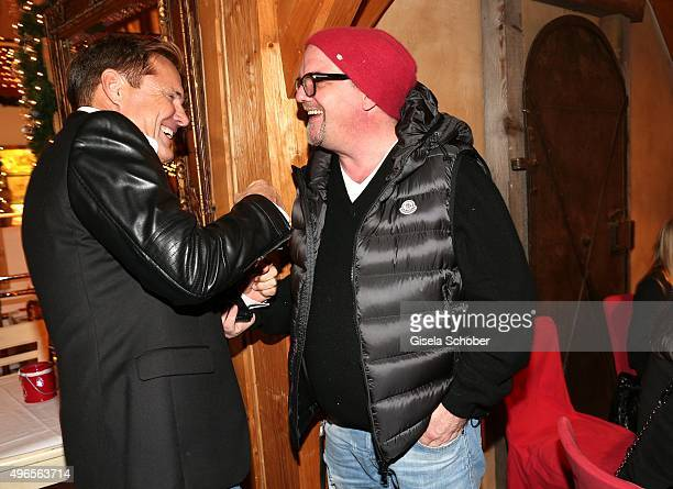 Dieter Bohlen and Gerry Friedle DJ Oetzi laugh together during the Gut Aiderbichl Christmas Market 2015 opening on November 10 2015 in Henndorf am...