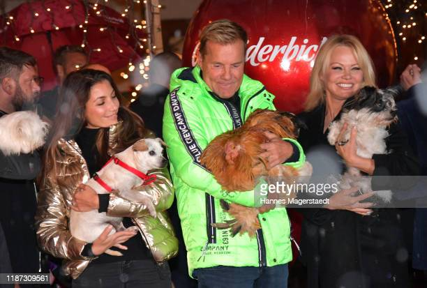 Dieter Bohlen and his partner Carina Walz and Pamela Anderson during the Gut Aiderbichl Christmas Market opening on November 12 2019 in Henndorf am...