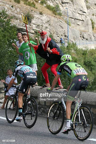 """Dieter """"Didi"""" Senft El Diablo of the Tour de France cheers on Matteo Trentin of Italy riding for Etixx-QuickStep and Ryder Hesjedal of Canada riding..."""