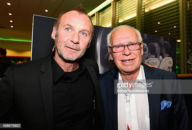 Dieter Eckstein and Manfred Reuter pose during the Club of former national players meeting at GrundigStadion on November 14 2014 in Nuremberg Germany