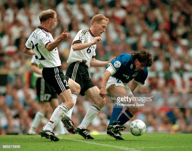 Dieter Eilts and Matthias Sammer of Germany put pressure on Gianfranco Zola of Italy during a UEFA Euro 96 group match at Old Trafford on June 19...