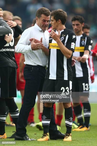 Dieter Hecking coach of Moenchengladbach shakes hands with Jonas Hofmann of Moenchengladbach during the Bundesliga match between Borussia...