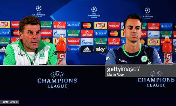 Dieter Hecking , head coach of Wolfsburg and goalkeeper Diego Benaglio attend the press conference ahead of the UEFA Champions League group B match...