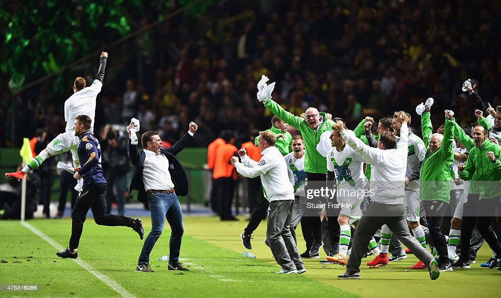 Dieter Hecking, head cosch of Wolfsburg celebrates winning at the end of the DFB Cup Final between Borussia Dortmund and VfL Wolfsburg at Olympiastadion on May 30, 2015 in Berlin, Germany.