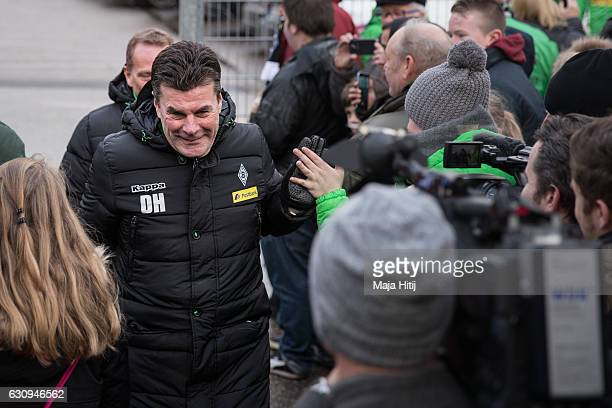 Dieter Hecking, the newly appointed head coach of Borussia Moenchengladbach is greeted by fans as he arrives to a training session on January 4, 2017...