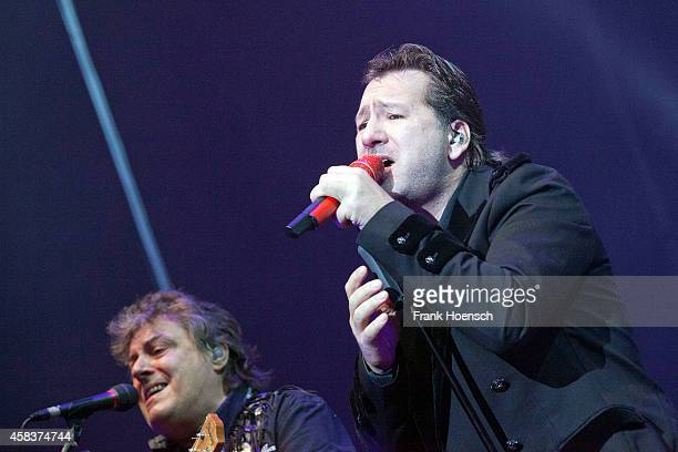 Dieter Hertrampf of the Puhdys and Claudius Dreilich of Karat perform live during the concert Rock Legends at the O2 World on November 1 2014 in...
