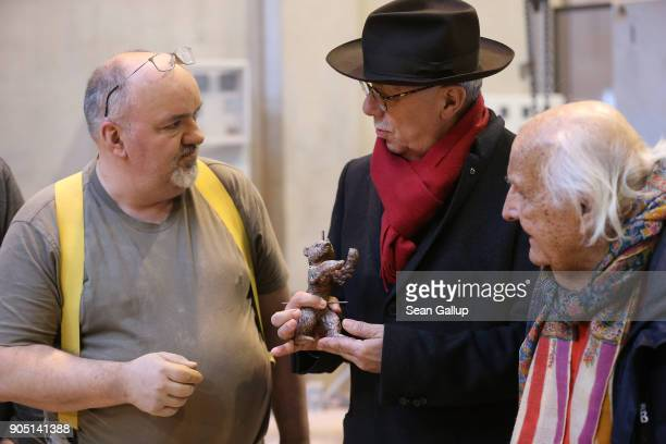 Dieter Kosslick Director of the Berlinale Berlin International Film Festival chats with artisan Manfred Koch as Hermann Noack the 3rd who cast the...