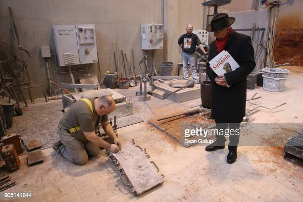 Dieter Kosslick Director of the Berlinale Berlin International Film Festival looks on as artisan Manfred Koch prepares a mould prior to casting a...