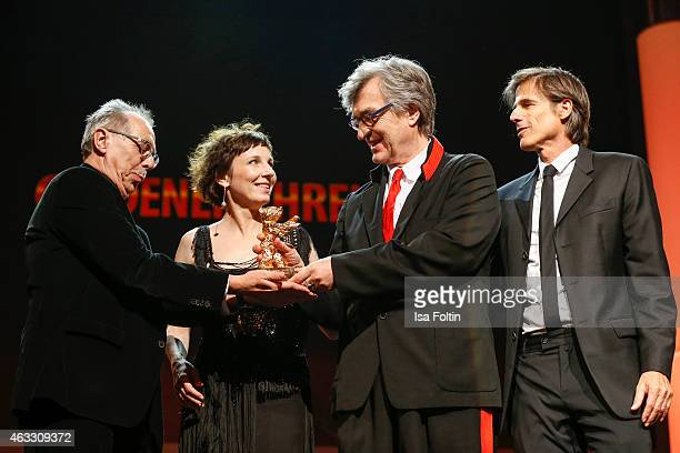 Dieter Kosslick, Meret Becker, Wim Wenders and Walter Salles attend the Honorary Golden Bear award for Wim Wenders during the 65th Berlinale...