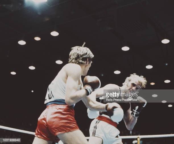 Dieter Kottysch of West Germany pictured in action on right against Wieslaw Rudkowski of Poland in the final of the light middleweight boxing event...