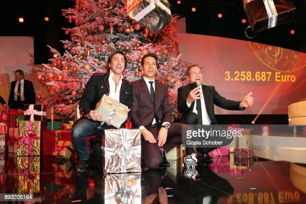 Dieter Landuris Alexander Mazza and Alexander Hold with presents during the 23th annual Jose Carreras Gala at Bavaria Filmstudios on December 14 2017...