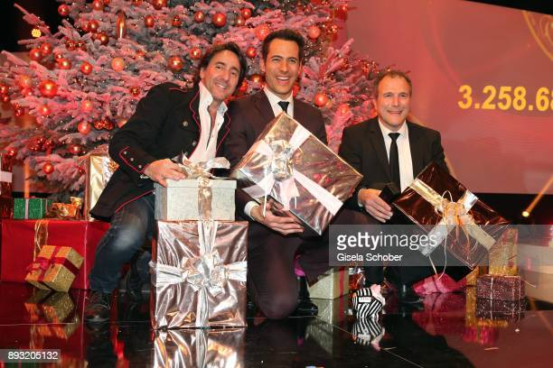 Dieter Landuris Alexander Mazza and Alexander Hold with presentsduring the 23th annual Jose Carreras Gala at Bavaria Filmstudios on December 14 2017...