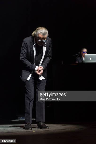 Dieter Meier and Boris Blank of Yello perform onstage at the Lanxess Arena on December 9 2017 in Cologne Germany