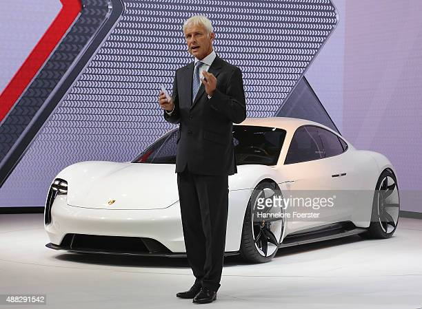 Dieter Mueller CEO Porsche AG presents the Porsche Mission E at the Porsche stand at the 2015 IAA Frankfurt Auto Show during a press day on September...