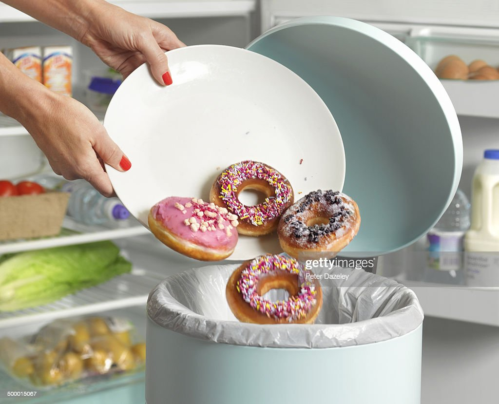 Dieter throwing away donuts : Stock Photo