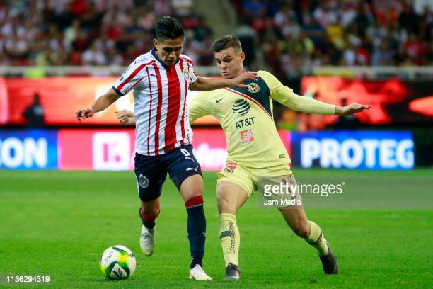Dieter Villalpando of Chivas fights for the ball with Nicolas Benedetti of America during the 11th round match between Chivas and America as part of...