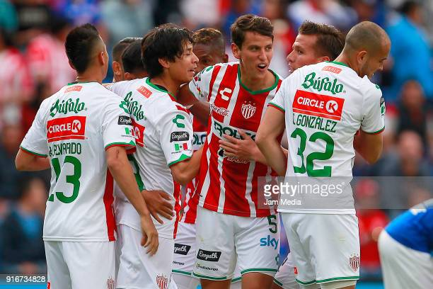 Dieter Villalpando of Necaxa celebrates with teammates after scoring the first goal during the 6th round match between Cruz Azul and Necaxa as part...