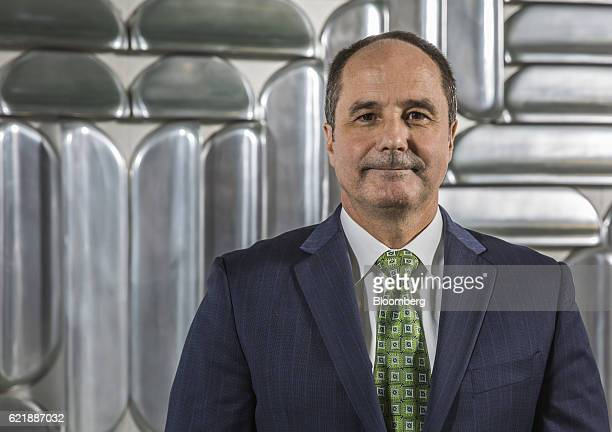 Dieter Weinand chief executive officer of Bayer AG's pharmaceutical unit poses for a photograph following an interview at Bayer's offices in Berlin...