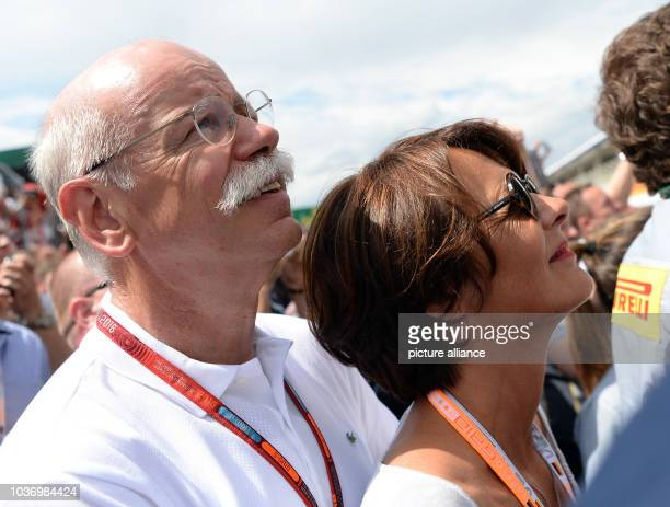 Dieter Zetsche CEO of Daimler AG and his French girlfriend Anne during the German Formula Grand Prix in the Hockenheimring in Hockenheim Germany 31...