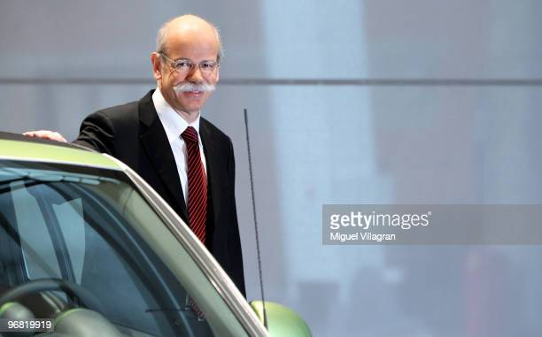 Dieter Zetsche CEO of Daimler AG poses next to a smart electric car during the company's annual press conference on February 18 2010 in Stuttgart...