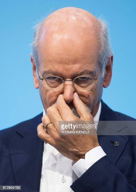 Dieter Zetsche CEO of German auto giant Daimler AG gestures during the company's annual press conference in Stuttgart southwestern Germany on...