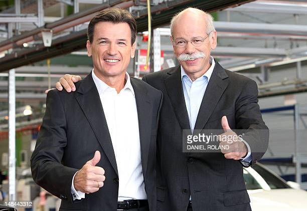 Dieter Zetsche CEO of German auto giant Daimler and executive board member Wolfgang Bernhardt hold their thumbs up as they visit the production line...