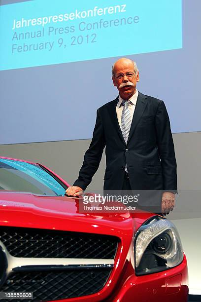 Dieter Zetsche CEO of German carmaker Daimler AG poses on front of a Mercedes SL 500 prior to the company's financial performance in 2011 during the...