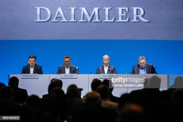 Dieter Zetsche CEO of Germany's Daimler AG Bodo Uebber member of the board and director for finances and Wolfgang Bernhard member of the board for...