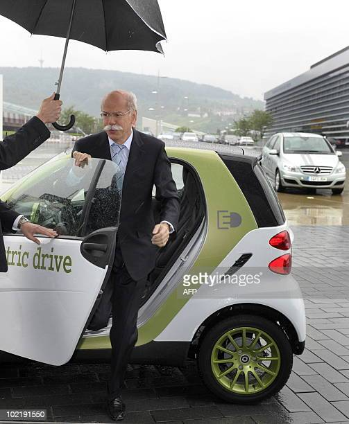 Dieter Zetsche CEO of the Daimler AG leaves an electric drive smart car as he arrives for a press conference at the MercedesBenz museum in Stuttgart...