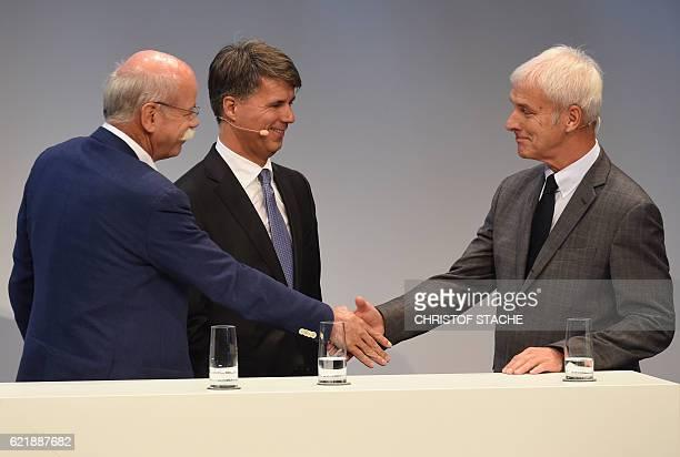 Dieter Zetsche CEO of the German car maker Daimler AG Harald Krueger CEO of the German car maker BMW and Matthias Mueller CEO of German car maker...