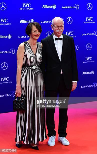 Dieter Zetsche chairman of Daimler AG and his partner Anne pose on the red carpet before the Laureus World Sports 2016 Awards Ceremony in Berlin on...