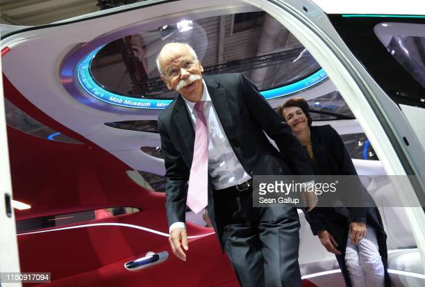Dieter Zetsche Chairman of Daimler AG and his wife Anne emerge from a Daimler Vision Urbanetic van at the annual Daimler AG shareholders meeting on...