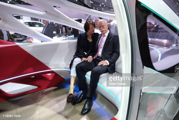 Dieter Zetsche Chairman of Daimler AG and his wife Anne sit in a Daimler Vision Urbanetic van at the annual Daimler AG shareholders meeting on May 22...