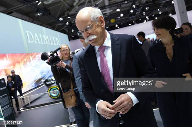 Dieter Zetsche Chairman of Daimler AG and his wife Anne walk among vehicles on display at the annual Daimler AG shareholders meeting on May 22 2019...