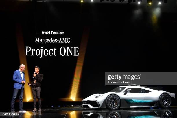 Dieter Zetsche Chairman of Daimler AG and Lewis Hamilton present the new concept car Mercedes AMG Project One at the MercedesBenz press conference at...